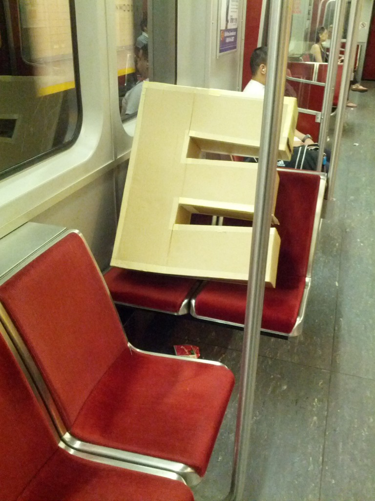 The Letter prop gets on the subway to get to our parking lot stage