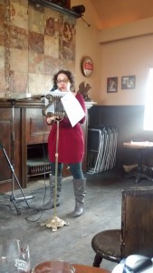A.M. Matte reading at an ornate gold-plated lectern in a west Toronto pub.